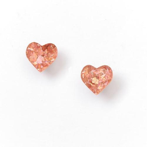 Heart studs pink.