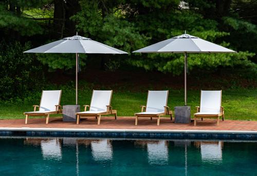 4- Bayhead Sling Chaise, 2-Concrete Cube,2-Umbrella bases, 2 -9' Umbrellas Vanilla Wood Pole Umbrella (different then  shown in picture)