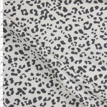 Grey Cheetah on Warm White Poly/Rayon French Terry Fabric By The Yard