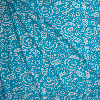 White Whimsy Floral on Turquoise Stretch Cotton Jersey Fabric By The Yard - Wide shot