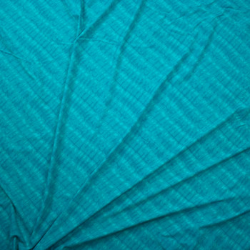 Turquoise Diagonal Ripple Designer Nylon/Spandex Fabric By The Yard - Wide shot