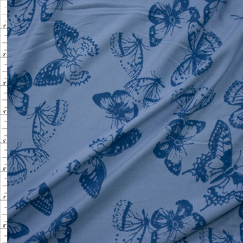 Royal Butterflies on Sky Blue Double Brushed Poly/Spandex Knit Fabric By The Yard