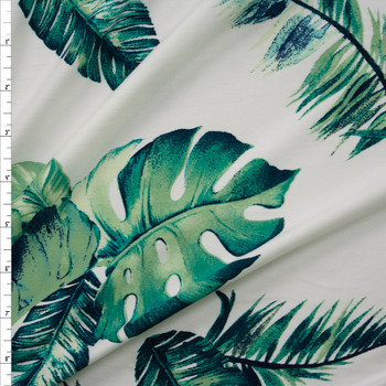 Island Palms on Warm White Double Brushed Poly/Spandex Knit Fabric By The Yard