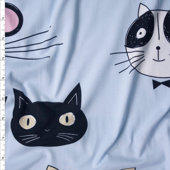 Feline Faces on Light Blue Double Brushed Poly/Spandex Fabric By The Yard