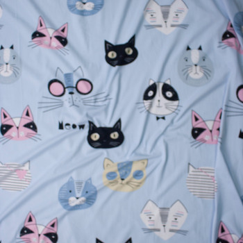 Feline Faces on Light Blue Double Brushed Poly/Spandex Fabric By The Yard - Wide shot
