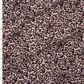 Black, Pink, and Ivory Cheetah on White Stretch Polyester Fashion Knit Fabric By The Yard