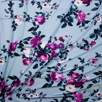 Midnight and Purple Rose Floral on Light Blue Stretch Rayon Jersey Fabric By The Yard - Wide shot