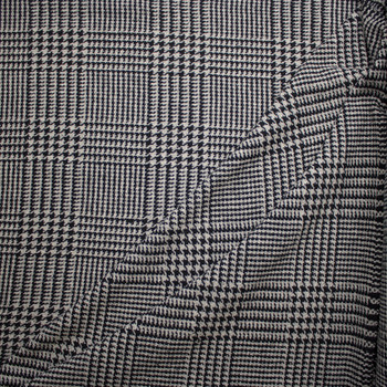 Grey and Black Houndstooth Plaid Wool Coating Fabric By The Yard - Wide shot