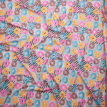 Bright Donuts on Black and White Dots and Stripes Spandex Print Fabric By The Yard - Wide shot