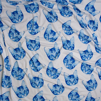 Blue Tossed Cats on White Double Brushed Poly Spandex Knit Fabric By The Yard - Wide shot