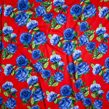 Blue Roses with Green Leaves on Bright Red Double Brushed Poly Spandex Fabric By The Yard - Wide shot