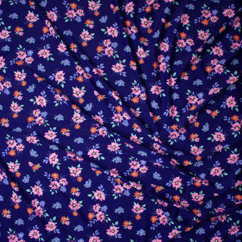 Pink, Orange, Periwinkle, and Mint Flowers on Navy Blue Nylon/Spandex Print Fabric By The Yard - Wide shot