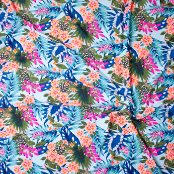 Green, Orange, Blue, Hot Pink, and Teal Tropical Flora on Aqua Nylon/Spandex Print Fabric By The Yard - Wide shot