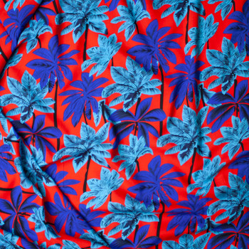 Royal Blue, Turquoise, and Black Palm Trees on Red Rayon Challis Fabric By The Yard - Wide shot