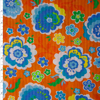 Blue, Yellow, and Lime Flowers on Orange 'Tutti Frutti' Plissé Fabric By The Yard