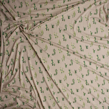 Green Cactus on Tan Double Brushed Poly/Spandex Knit Fabric By The Yard - Wide shot