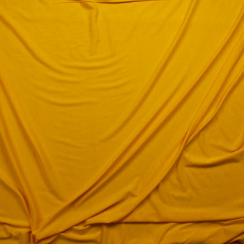 Bright Goldenrod Lightweight Poly/Rayon Jersey Fabric By The Yard - Wide shot
