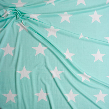 Large White Stars on Mint Green Poly/Rayon French Terry Fabric By The Yard - Wide shot