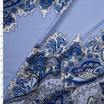 Blue and White Paisley Diagonal on Light Blue Poly/Spandex Knit Fabric By The Yard