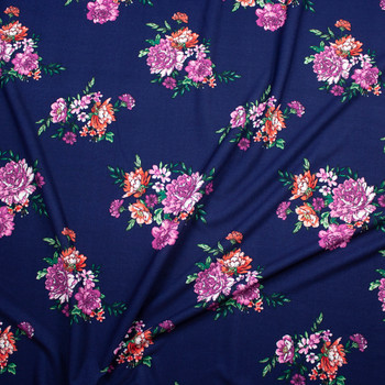Red, Green, and Purple Floral on Navy Blue Midweight Crepe Knit Fabric By The Yard - Wide shot