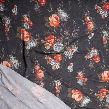 Red Orange, Blue, and Tan Rose Floral on Charcoal Heather Stretch Rayon French Terry Fabric By The Yard - Wide shot