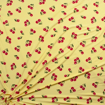 Cherries on Light Yellow Double Brushed Poly/Spandex Fabric By The Yard - Wide shot