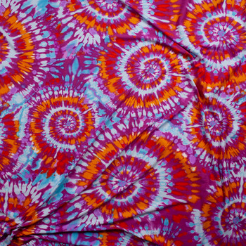 Red, Orange, Aqua, and Lilac Pinwheel Tie Dye Double Brushed Poly/Spandex Fabric By The Yard - Wide shot