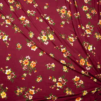 Orange and Yellow Wildflowers on Burgundy Double Brushed Poly Fabric By The Yard - Wide shot