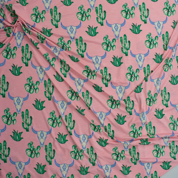 Cactus and Bull Skulls on Pink Lightweight Stretch Poly/Spandex Knit Fabric By The Yard - Wide shot