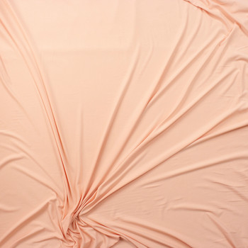 Light Peach Solid Double Brushed Poly Spandex Fabric By The Yard - Wide shot