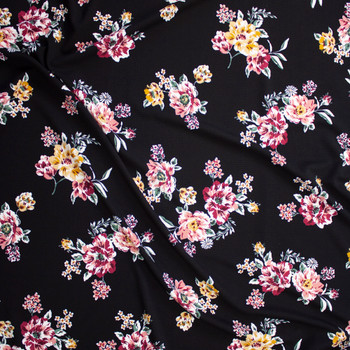 Mauve and Magenta Floral on Black Crepe Liverpool Knit Fabric By The Yard - Wide shot