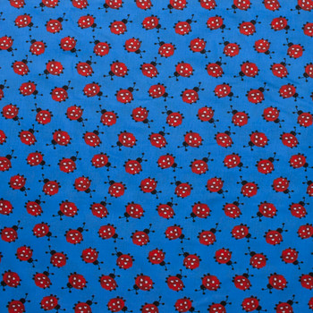 Ladybugs on Blue Quilter's Cotton Fabric By The Yard - Wide shot