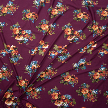 Orange and Blue Floral on Wine Double Brushed Poly/Spandex Fabric By The Yard - Wide shot