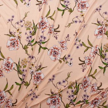 Green, Rose, Purple, and Yellow Flowering Branch on Peach Double Brushed Poly Spandex Knit Fabric By The Yard - Wide shot