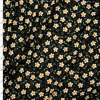 White Mini Floral on Black Double Bushed Poly/Spandex Fabric By The Yard