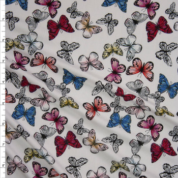 Butterflies on Warm White Double Brushed Poly/Spandex Knit Fabric By The Yard