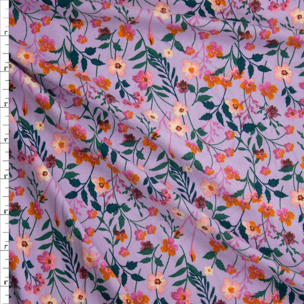 Orange, Pink, and Emerald Small Floral on Lavender Double Brushed Poly/Spandex Fabric By The Yard