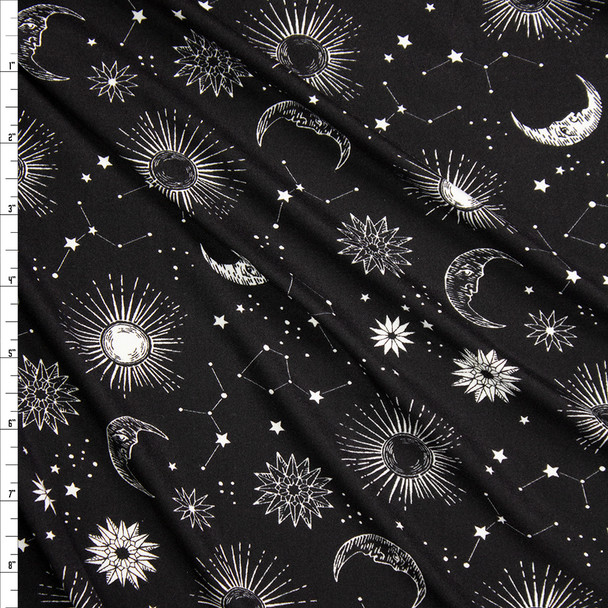 White Sun, Moon, and Stars on Black Double Brushed Poly/Spandex Fabric By The Yard