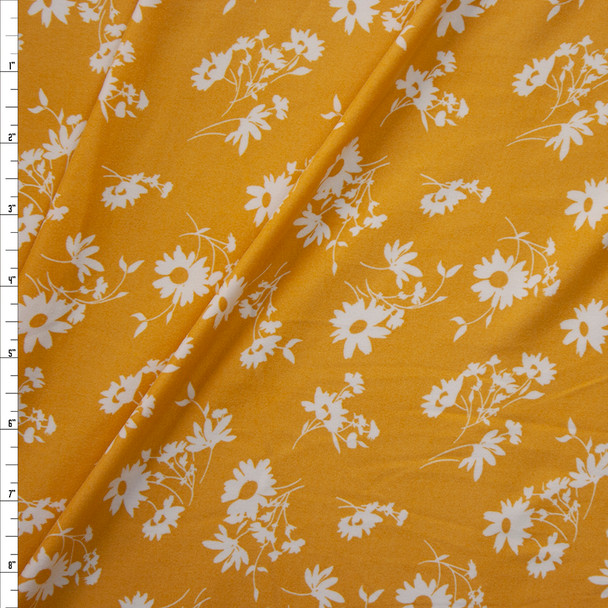 Offwhite Floral Silhouettes on Mustard Double Brushed Poly Knit Fabric By The Yard