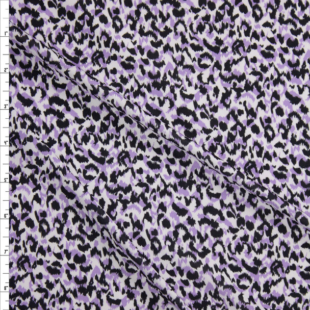 Lavender and Black Cheetah Print on White Lightweight Stretch Poly Knit Fabric By The Yard