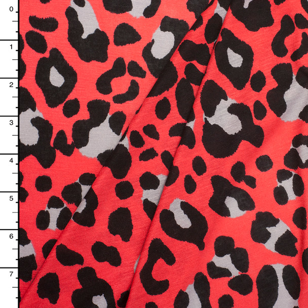Black and Grey Leopard on Red-Orange Jersey Knit