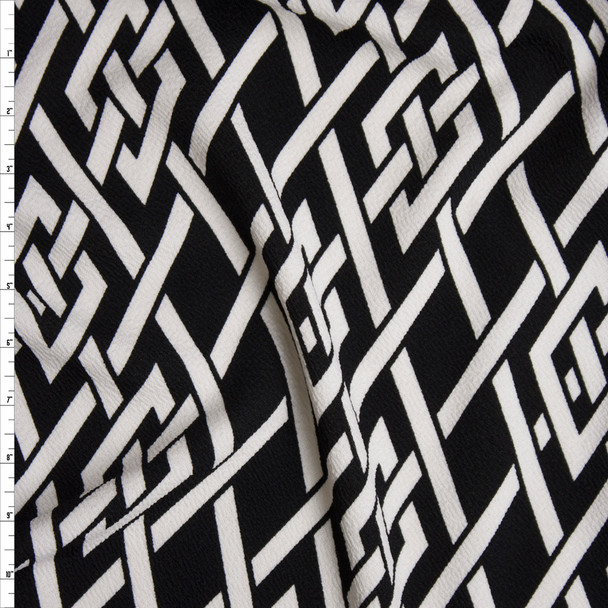 White Braided Knot on Black Liverpool Knit Fabric By The Yard