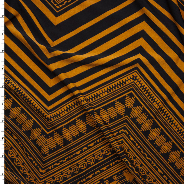 Black and Golden Orange Patterned Chevron Lightweight Poly Knit Fabric By The Yard
