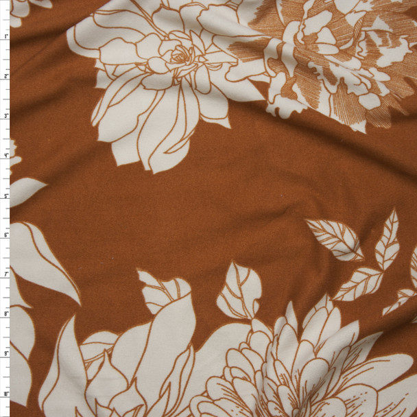 Ivory Hand Drawn Flowers on Rust Double Brushed Poly/Spandex Knit Fabric By The Yard