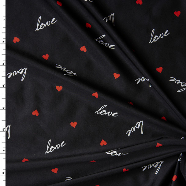 Cursive 'Love' with Red Hearts Nylon/Spandex Print Fabric By The Yard