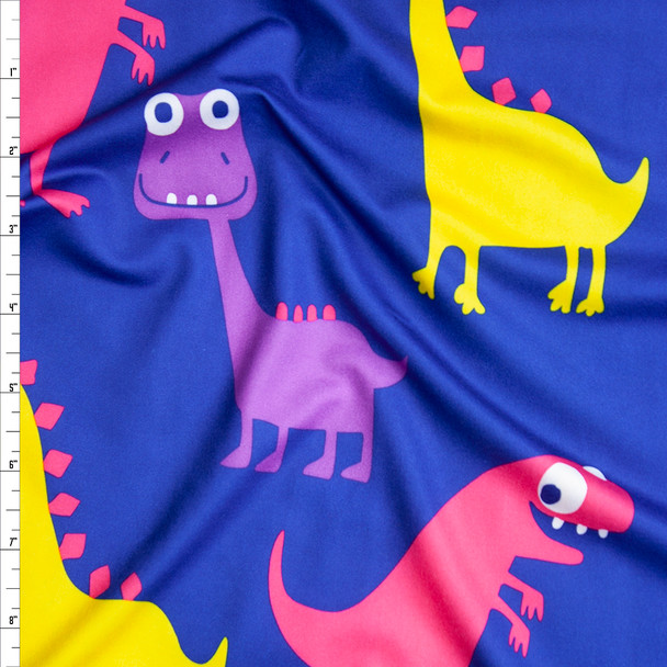 Red, Yellow, and Purple Fun Dinosaurs on Bright Blue Brushed Poly Spandex Fabric By The Yard