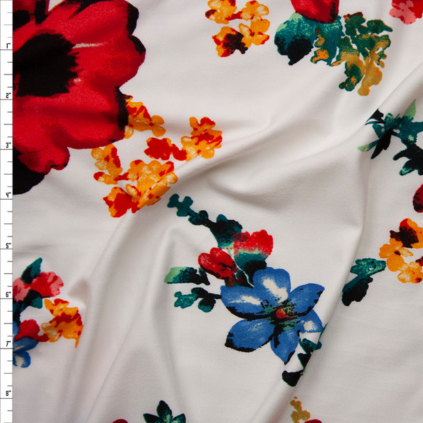 Bright Red, Blue, Green, and Yellow Floral on White Double Brushed Poly Spandex Fabric By The Yard