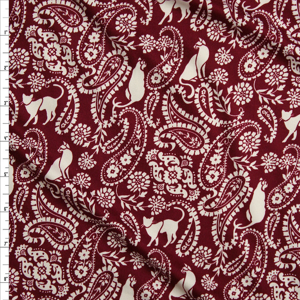 Offwhite Cats and Paisleys on Burgundy Double Brushed Poly/Spandex Knit Fabric By The Yard