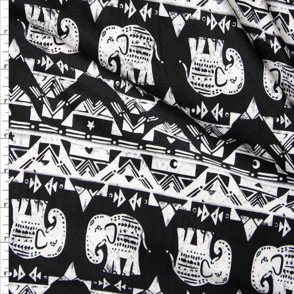 White Horizontal Elephant Stripes on Black Double Brushed Poly Spandex Fabric By The Yard