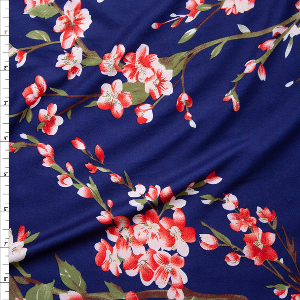 Hot Coral, White, Sage, and Rust Brown Flowering Branches on Deep Blue Double Brushed Poly/Spandex Knit Fabric By The Yard